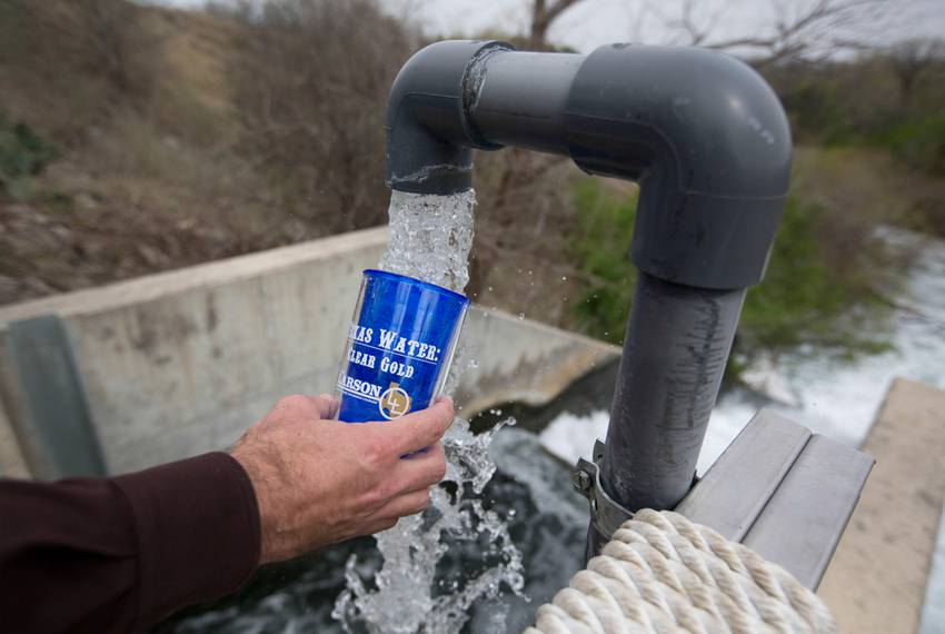 Attendees of a San Antonio Water System facility tour sampled treated water at the Dos Rios Water Recycling Center outside...