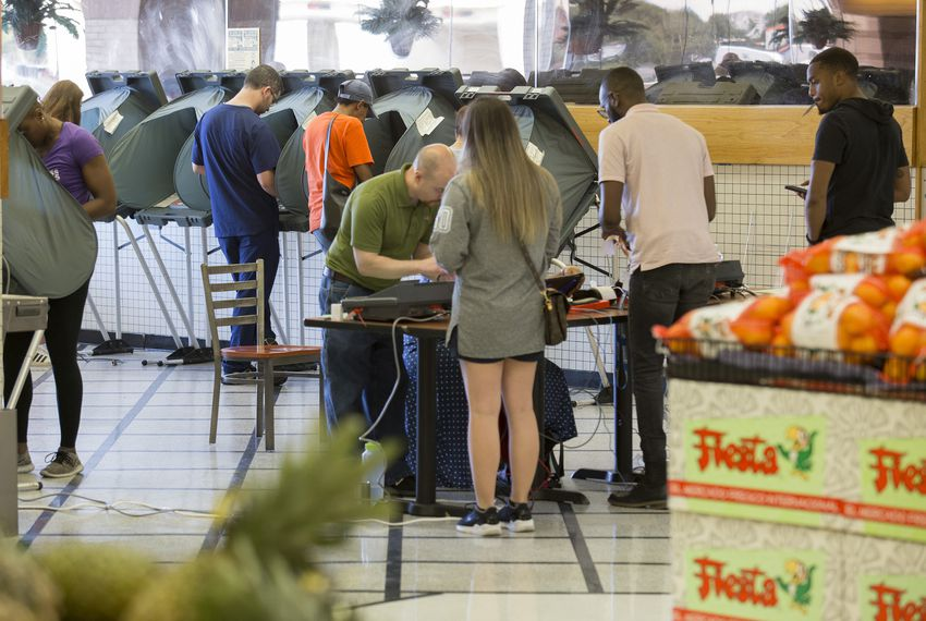 Voting inside a Fiesta grocery story in Houston on Tuesday Nov. 6, 2018.