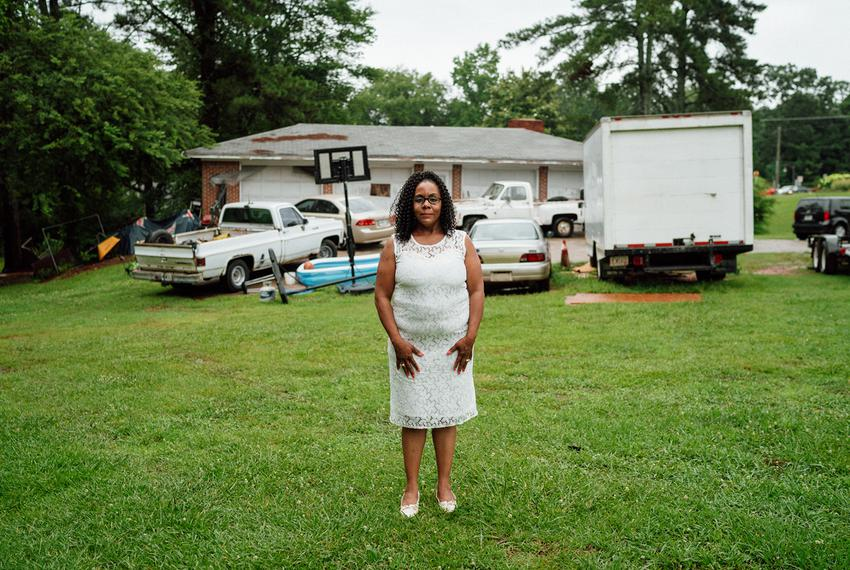Melissa Alford stands in her yard, where members of a Confederate pride group terrorized a family birthday party she hosted …