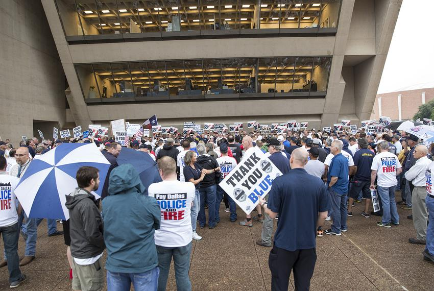 Dallas police officers and firefighters protest their failing pension fund outside City Hall in Dallas on April 26, 2017.