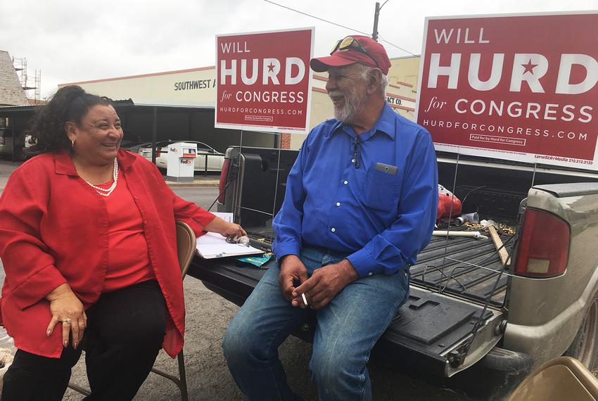 Bea Vallejo, 60, and Pete De Hoyos, 70, talk to one another outside an early voting location Tuesday in Del Rio. They are su…