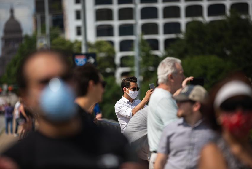 Austin residents take photos on Congress Avenue bridge in Austin on May 13, 2020.