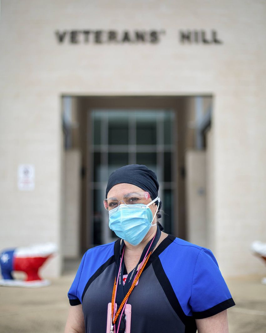 Marisa Thomison  in front of Veterans' Hill Elementary School in Round Rock on March 12, 2021.