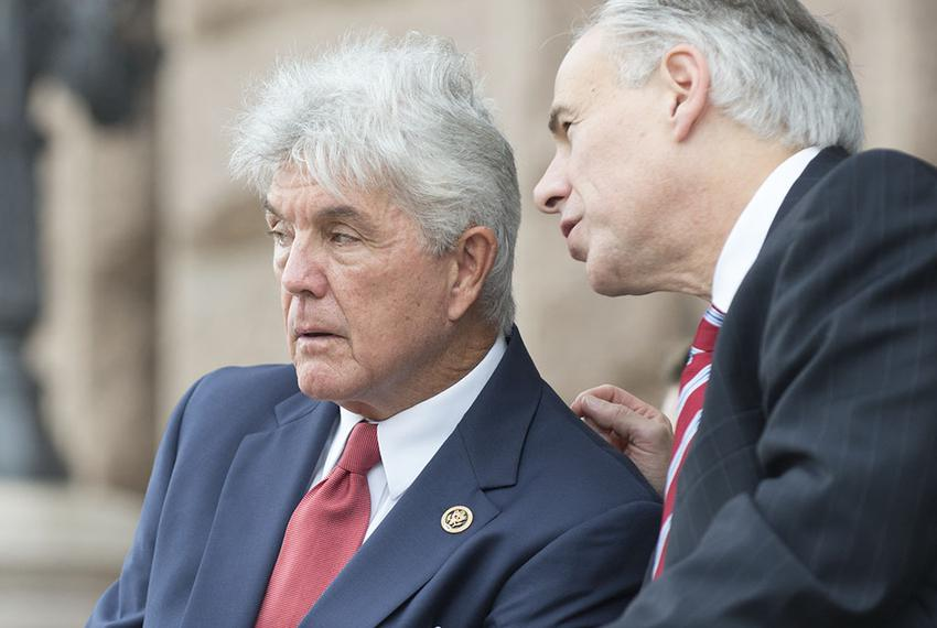 Comgressman Roger Williams of Texas' 25th District talks with Gov. Greg Abbott during Veteran's Day ceremonies at the Texas …