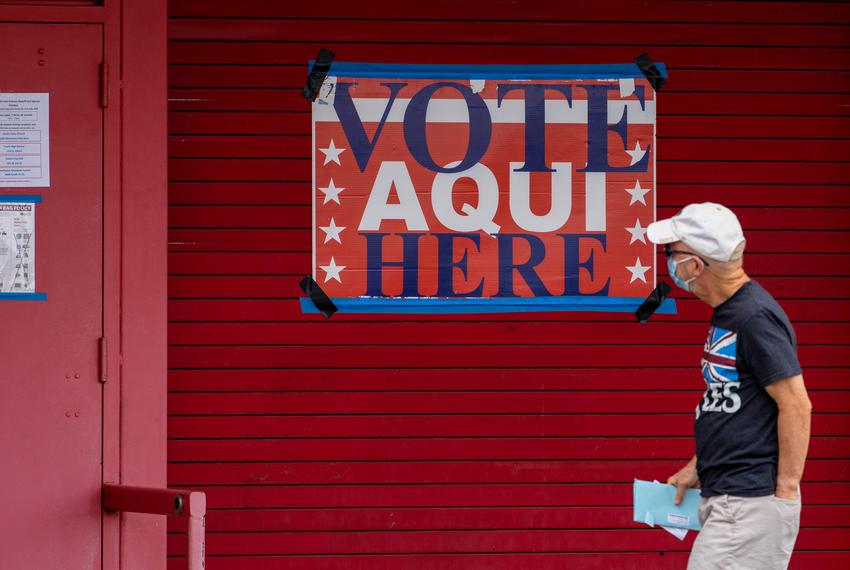 A man enters Toney Burger stadium in South Austin where early voting has begun for the July 14 runoff and special election, …