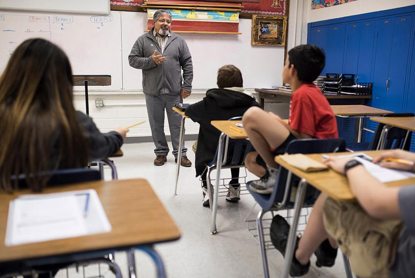 Ramon Cavazos teaches a middle school business class in the Olfen Independent School District in Rowena, Texas, on Jan. 20, …