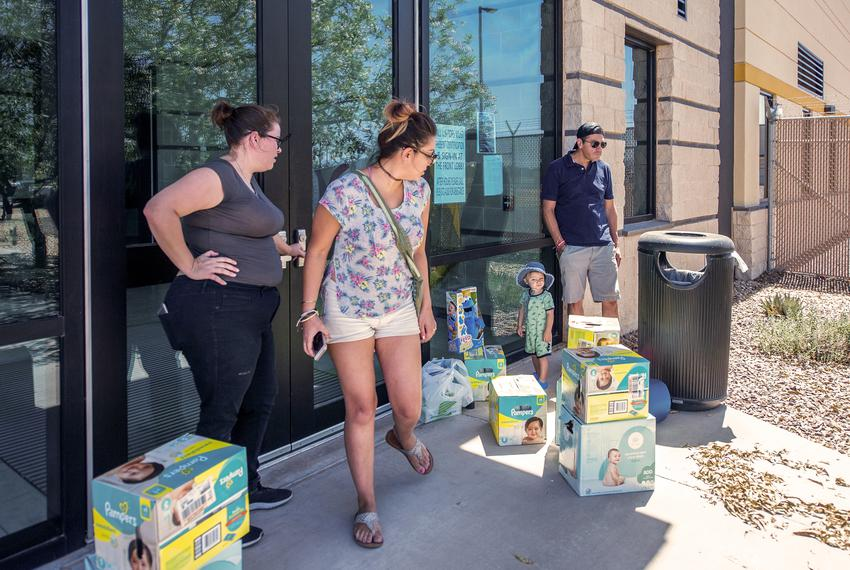 From left: Meagan O'Toole-Pitts, Ashley Cortez, Oliver Cortez and his father Mark Cortez attempt to drop-off diapers and toy…