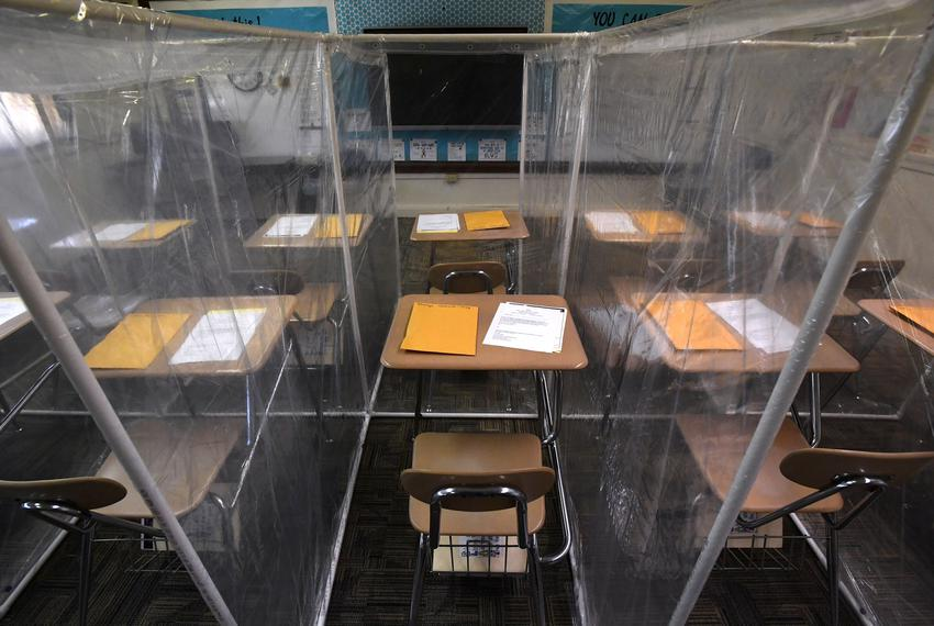 Partitions made from clear shower curtains and PVC pipe separate desks in a fourth grade classroom at Abilene's Texas Lead...