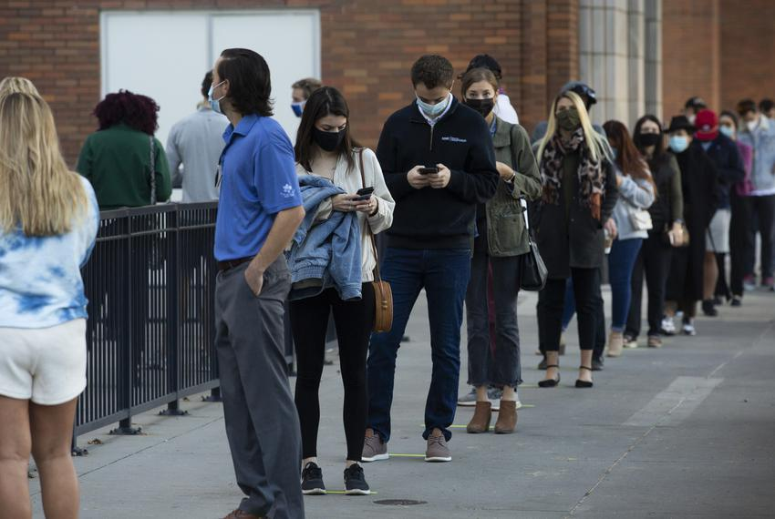 Voters stand in line at the American Airlines Center to cast their ballots on Election Day in Dallas. Nov. 3, 2020.