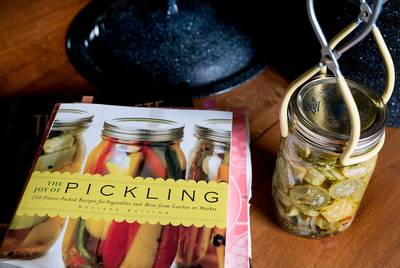 A book and pickles on the McHaney's kitchen table.