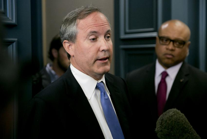Texas Attorney General Ken Paxton speaks to media after keynoting a June 2015 event hosted by the Texas Public Policy Foun...