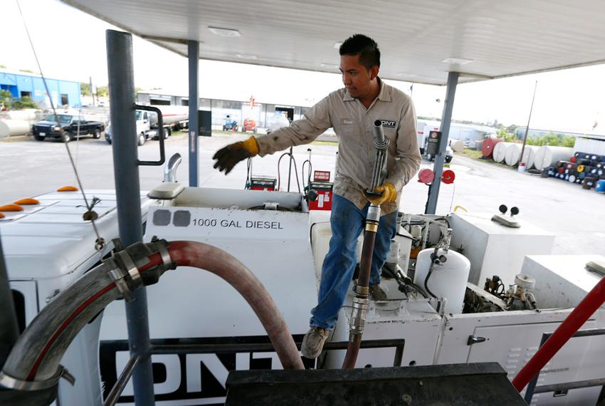 Ismael Gonzalez, 22, with DNT Construction filled his tanker truck with dyed diesel fuel at Tex-Con Oil Company on May 20,...