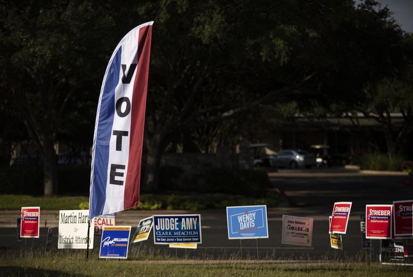 Voting signs at a polling site at the Austin Oaks Church on Oct. 14, 2020.