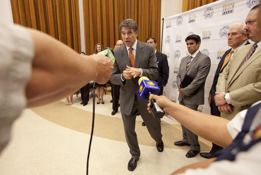 Gov. Rick Perry answers a question on the south Texas university merger following the ceremony at UT-Brownsville on July 16,…