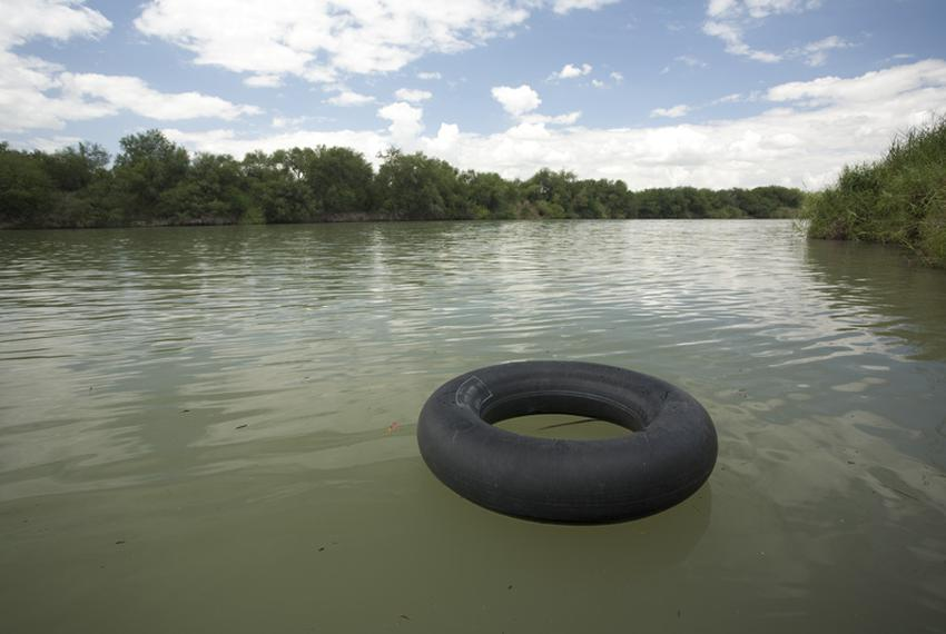 An inner tube floats down the Rio Grande River in Hidalgo County, TX  on August 25, 2011.  Truck tubes and floats are common…