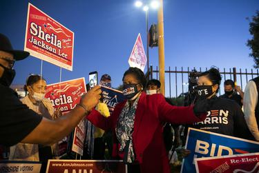 Congresswoman Sheila Jackson Lee, center, joins the family of George Floyd in cheering on Biden supporters outside of the Metropolitan Multi-Services Center during Election Day in Houston on Nov. 3, 2020.