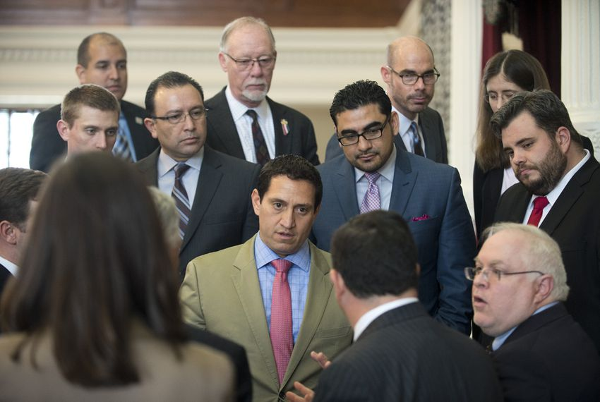 San Antonio Democratic Rep. Trey Martinez Fischer, c, confronts State Rep. Larry Phillips, R-Sherman, with a Point of Order on HB 910 that delayed the open carry gun bill on April 14, 2015.