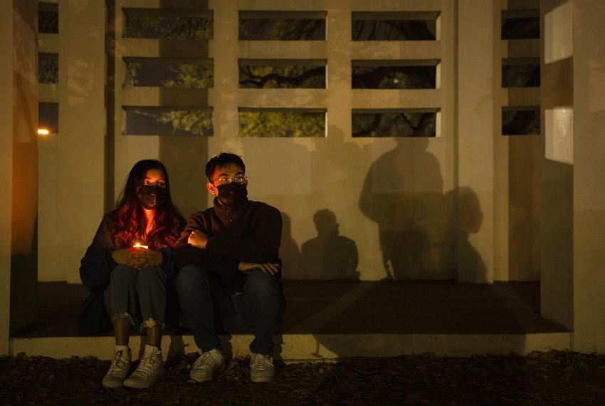 Anshu Shrestha and Jospeh Matawaran sat near the vigil held at the Grassy Knoll in Dallas. The group gathered to denounce ra…