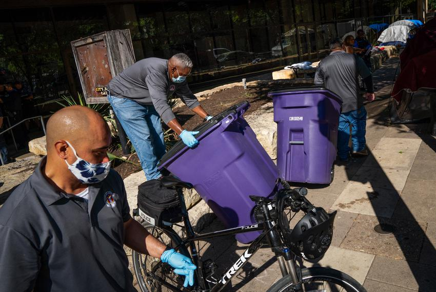 Members of the Austin Police Department clear homeless encampments around City Hall on June 14, 2021.