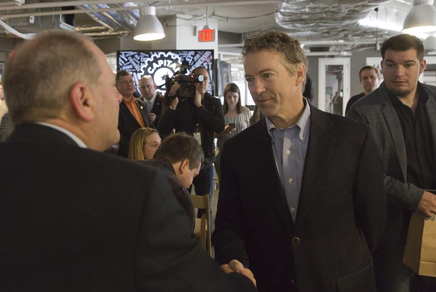 Sen. Rand Paul speaks to supporter after briefly addressing public at the opening of his new office at the downtown Austin...