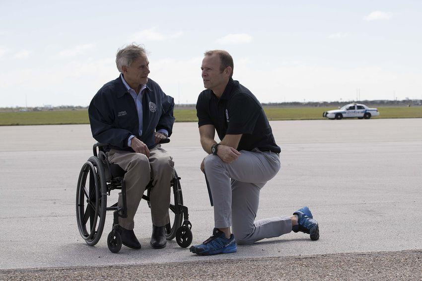 "Gov. Greg Abbott, left, and FEMA DirectorWilliam B. ""Brock""Long talk on the tarmac of Corpus Christi International Airport before President Trump arrives to assess damage from Hurricane Harvey on Tuesday, Aug. 29, 2017."