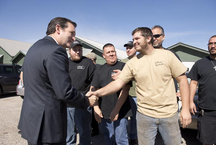 U.S. Sen. Ted Cruz, R-Texas, l, shakes hands with LaRue Tactical employees at his arrival Feb. 19, 2013 at their Leander pla…