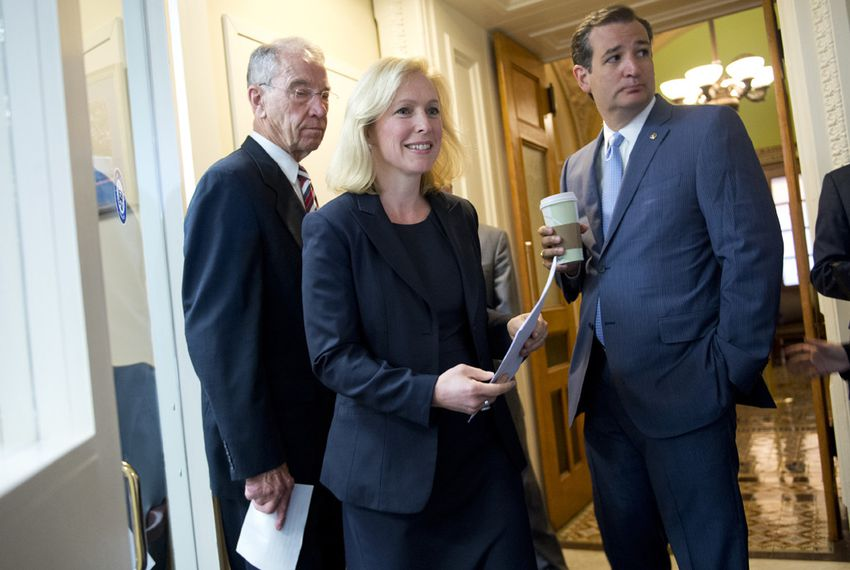 U.S. Sens. Kirsten Gillibrand, D-New York, and Ted Cruz, R-Texas, joined fellow Sen. Charles Grassley (left), R-Iowa, ahead of a July 16, 2015, Capitol news conference on legislation creating a process for reviewing cases of military sexual assault and alleviating victims' fears of reporting an incident.