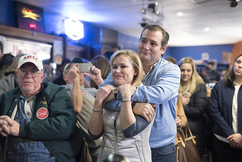 Ted and Heidi Cruz snuggle during the introductions at 3 Generations Bar & Grill in Ringsted, Iowa on Jan. 29, 2016.