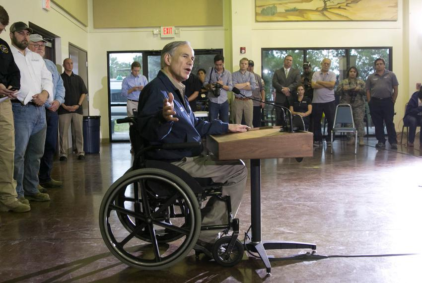 Governor Greg Abbott speaks to media at the Wimberley Community Center a day after the area suffered from devastating floods.