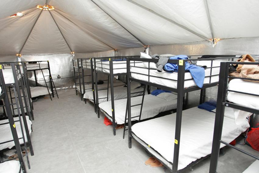 Bunk beds are lined up inside an air-conditioned tent at the Tornillo facility for unaccompanied immigrant children near E...