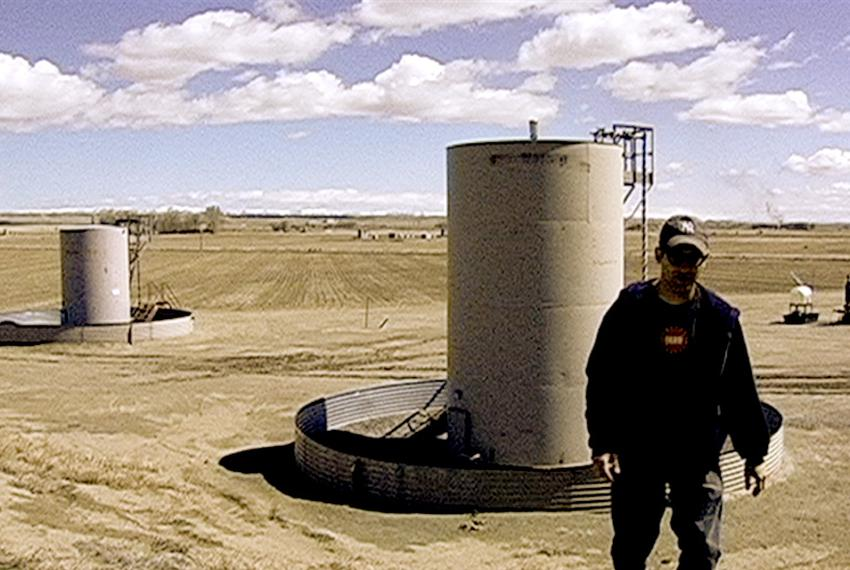 "Josh Fox, creator of ""Gasland,"" stands in a Wyoming gas field."