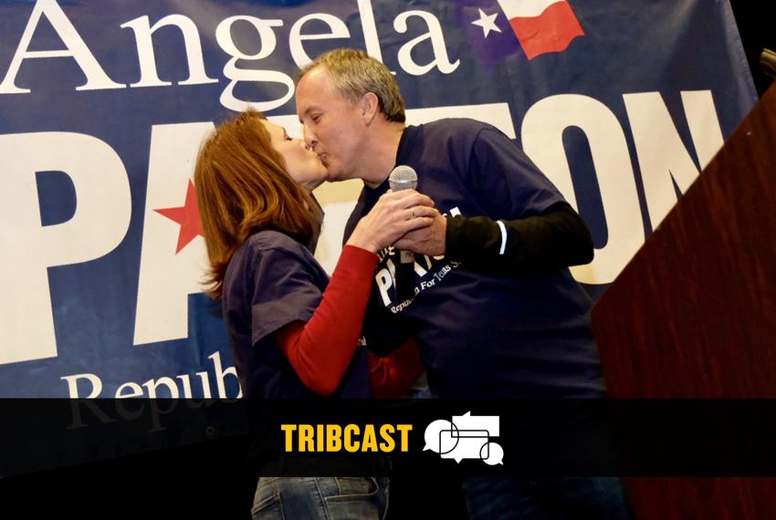 Angela Paxton kisses her husband, Texas Attorney General Ken Paxton, at her primary election night watch party inAllen on...