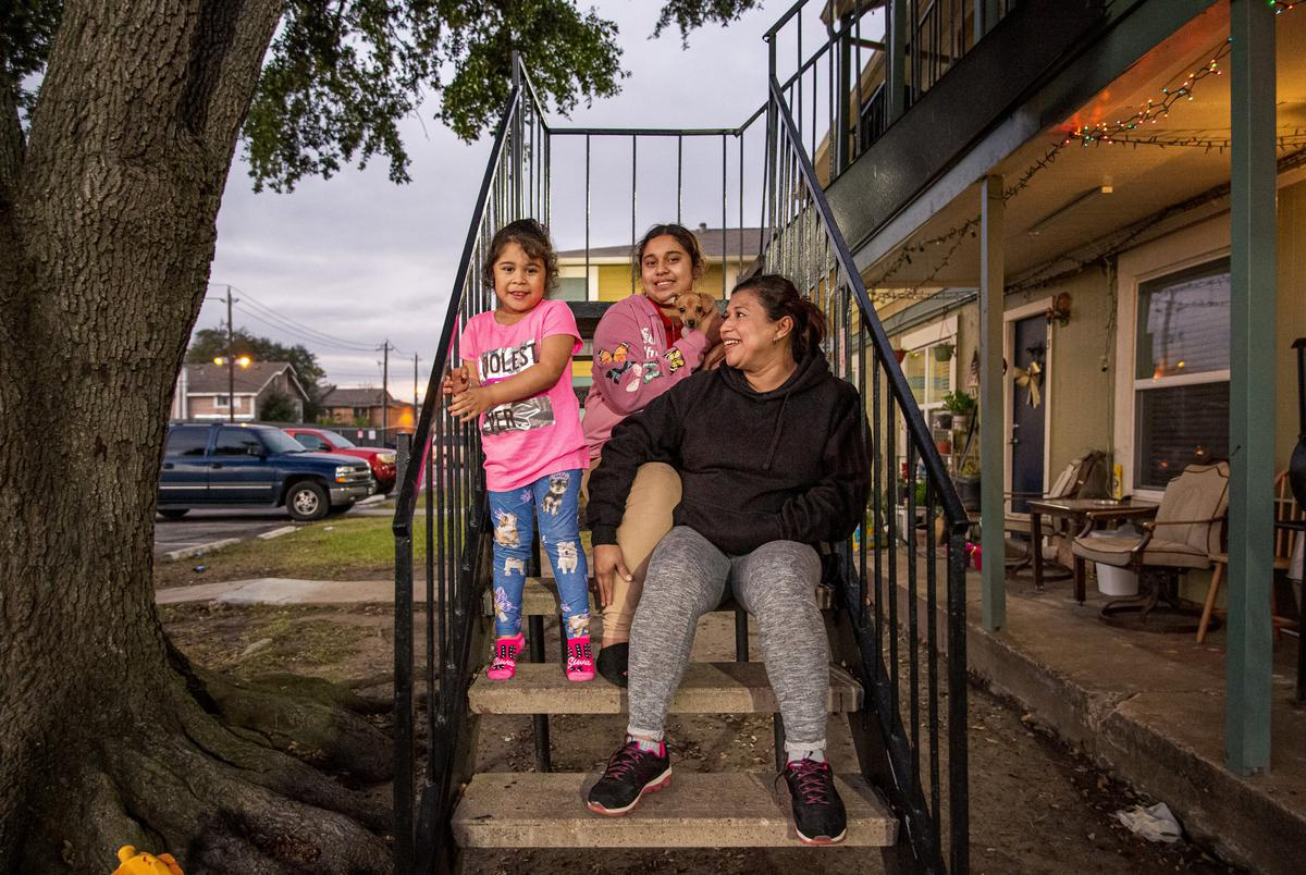 Elsa Ramirez, and her daughters Josseline, 11, and Francheska, 4, stand outside their home in Houston on Dec. 14, 2020. She and her three kids have managed to stay housed in her two-bedroom apartment, thanks to a federal eviction moratorium that expires at the end of the month.