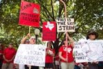 A group of educators from Gordon, Texas applaud a speaker at the Texans for Public Education rally on the Capitol steps on Monday, July 17, 2017.