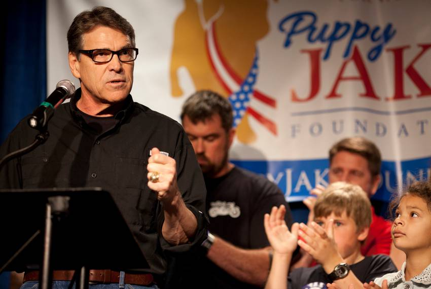 Former Gov. Rick Perry speaks to an audience of veterans and supporters at a fundraiser for the Puppy Jake Foundation in I...
