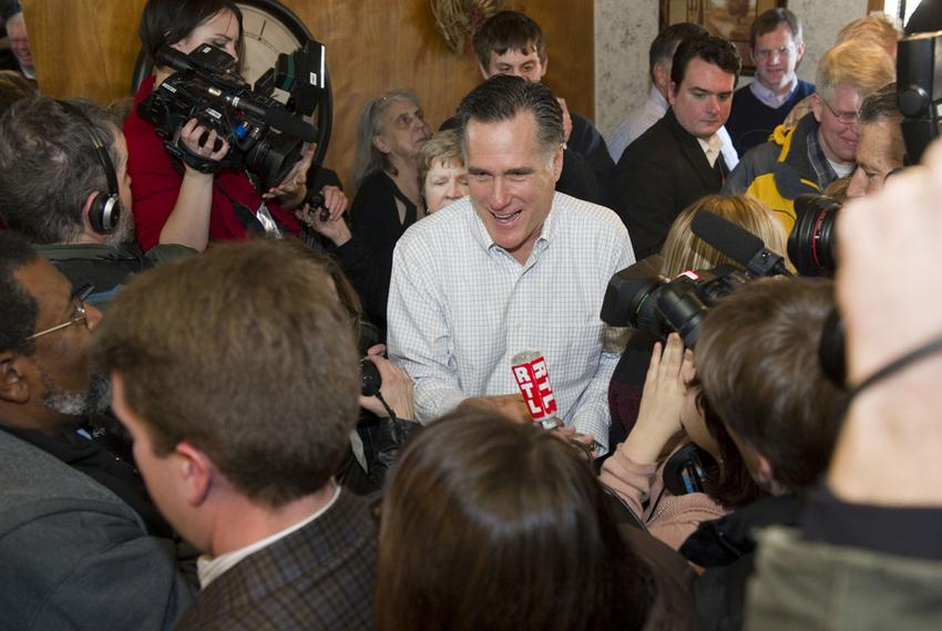 Mitt Romney surrounded by media as he makes a campaign stop at the Family Table Restaurant in Atlantic, Iowa, in January 2...