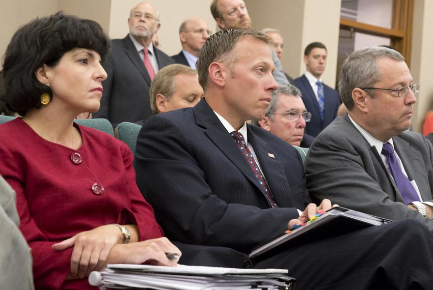 Texas Railroad Commissioners Christi Craddick, Ryan Sitton and David Porter wait for their turn to testify before the Sunset…