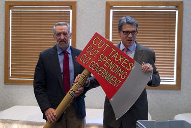 Gov. Rick Perry poses with a traditional New Hampshire prop at an Americans for Prosperity event in Manchester on Friday.