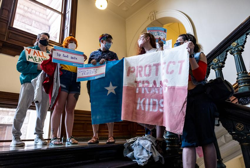 Transgender rights activists gather outside the entrance to the House floor on May 23, 2021.