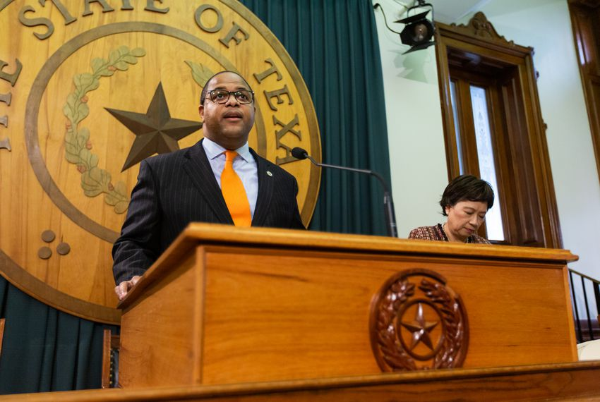State Rep. Eric Johnson, D-Dallas, is joined by state Rep. Angie Button, R-Richardson, during a press conference at the Capitol to announce an anti-corruption bill on Mar. 4, 2019.