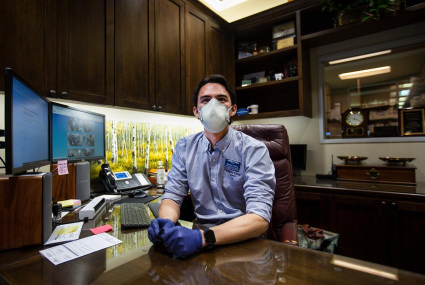 Pharmacist-In-Charge Rannon Ching poses for a portrait in his office at Tarrytown Pharmacy in Austin on Jan. 14, 2021.