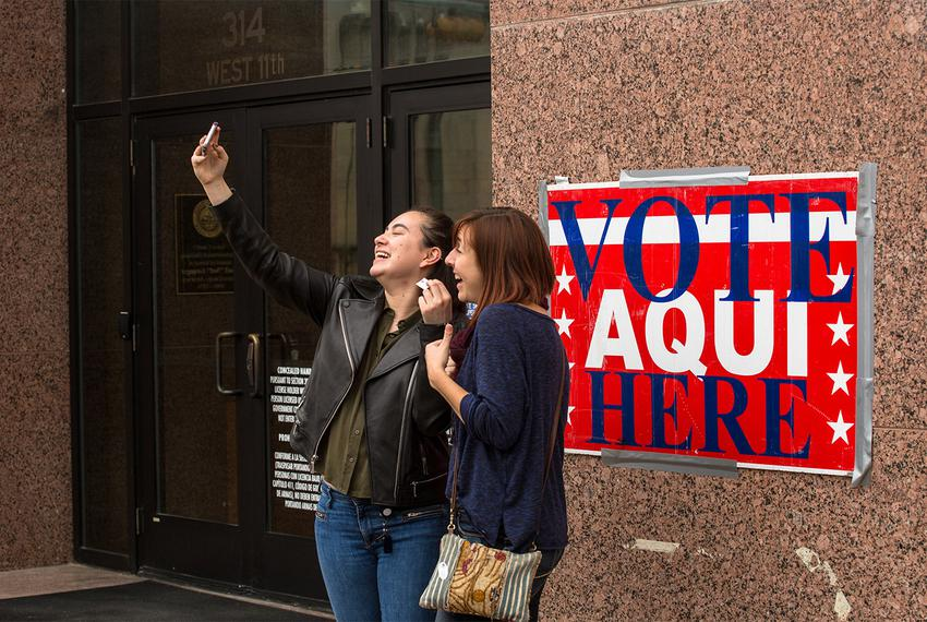 Voters take a selfie outside an early voting station in Austin on Feb. 23, 2018.