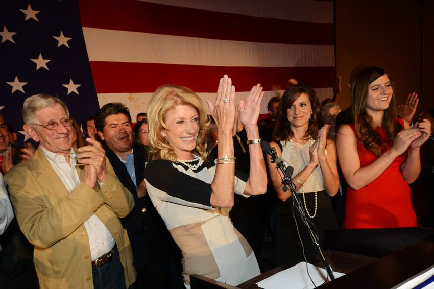 State Sen. Wendy Davis, flanked by her father, Jerry Russell, and her two daughters, delivering her victory speech at the Fort Worth Hilton on Nov. 6, 2012.