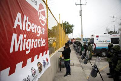 Mexican police and military line the exterior of the shelter currently holding an estimated 1700 migrants. According to the Ministry of Public Security of Coahuila, Josà Luis Pliego, the situation in Piedras Negras is under control, but the shelters are at capacity. ìWe have all six of the shelters in Piedras Negras at maximum capacity. This shelter is also at maximum capacity. This shelter was built specifically for the caravan.î  Feb. 9, 2019.