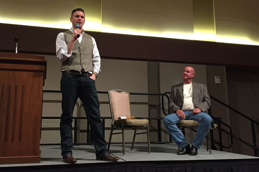 White nationalist Richard Spencer speaks at Texas A&M University in College Station while Preston Wiginton, who privately arranged the event, listens, on December 6, 2016.
