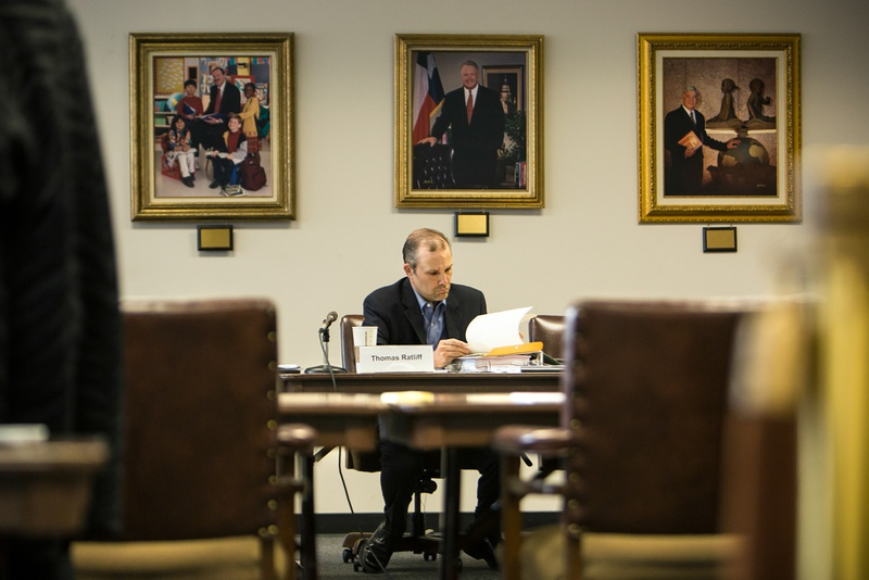 State Board of Education Vice Chair Thomas Ratliff leafs through binders at the meeting listing proposed changes to Texas textbooks in a SBOE meeting in Austin on Monday, October 20, 2014 .Textbook publishers were invited to meeting where public concerns regarding their textbooks were discussed.