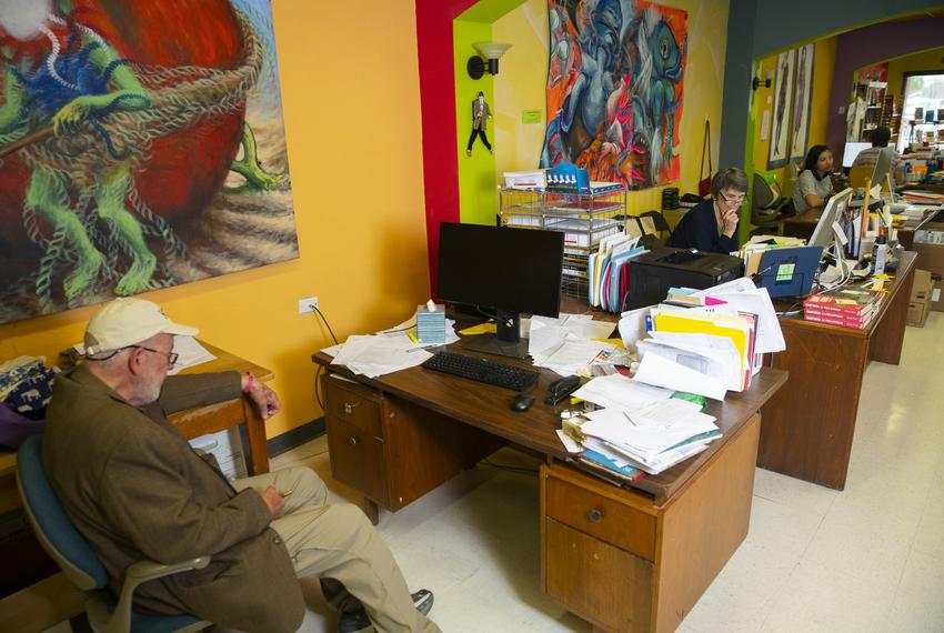 Left and center: Bobby and Lee Byrd at their desks at the Cinco Puntos publishing house in El Paso.