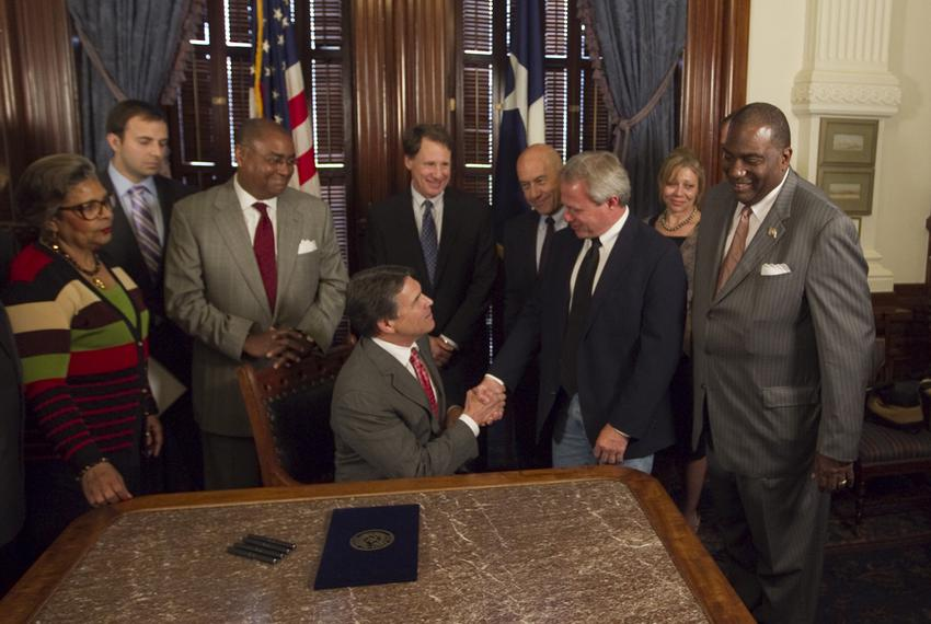 Gov. Rick Perry ceremonially signs Senate Bill 1611, known as the Michael Morton Act, which requires prosecutors to disclose…