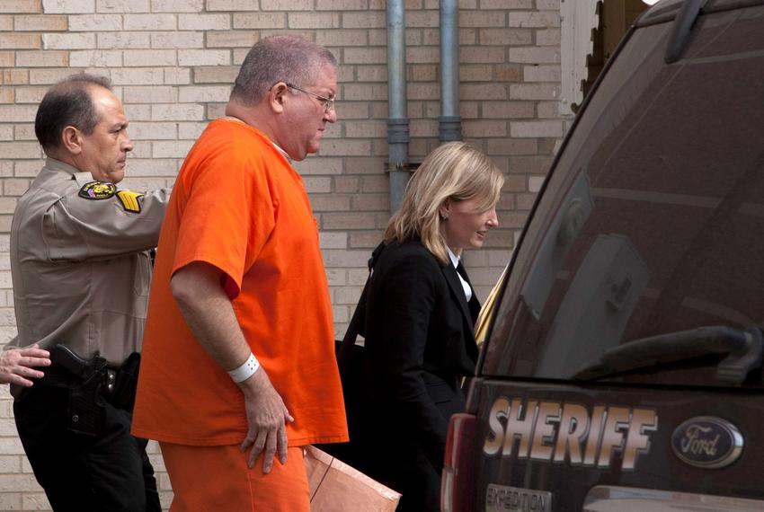 Bernhardt Tiede exits the Panola County Court building with his attorney Jodi Cole after his hearing on February 5, 2014 i...