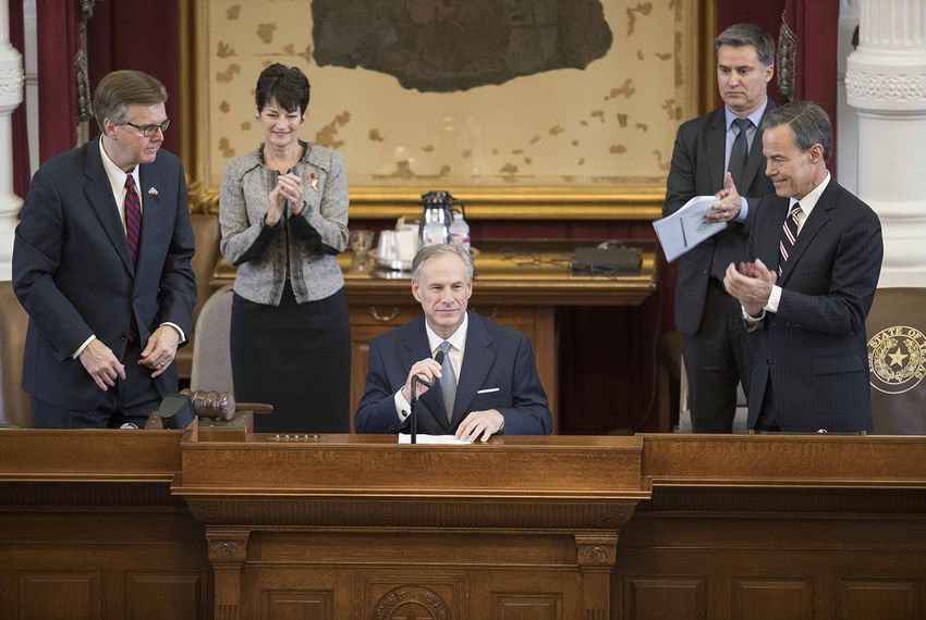 Lt. Gov. Dan Patrick, Gov. Greg Abbott and House Speaker Joe Straus on the dais in the Texas House chamber for a ceremony memorializing the nation's veterans on May 27, 2017.